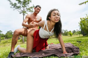 Sexy black teen girl in red panties fucked by white guy on the green grass