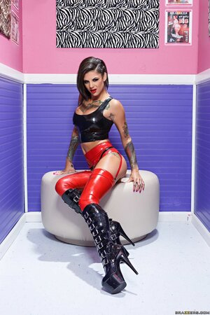 Chick in vinyl stockings and high leather boots provides sexual pleasure for fans