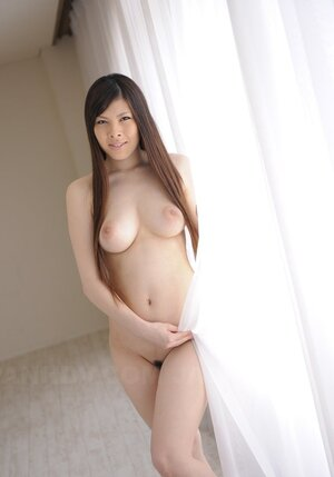 Nude Japanese sweetie gladly demonstrates impressive natural melons on cam