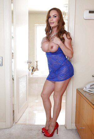 Solitary pictures of outstand additionallying MILF with red hair and additionally awesome fake chest