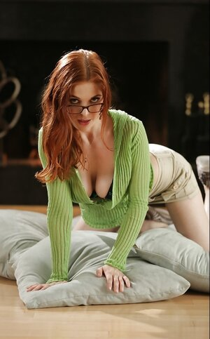 Captivating redhead Penny Pax flaunts natural jugs and hairy pussy on the pillow