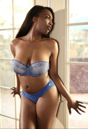 Ebony broad poses undressed by a window without fear of being caught by neighbors