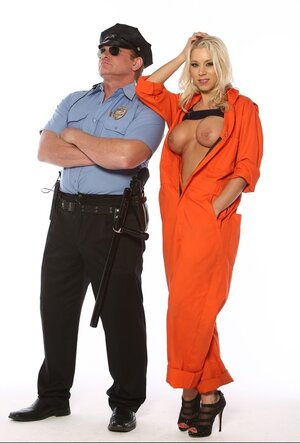 Tricky blonde inmate unzips orange uniform to lower prison warden's guard