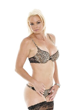 Excited diva takes leopard underwear off to open her melons and moreover snatch