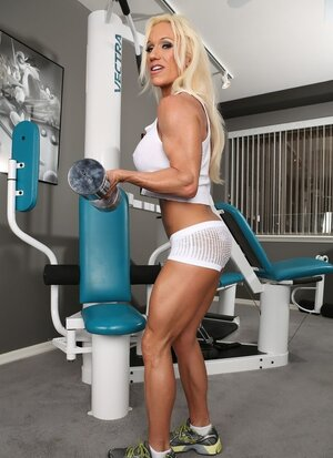 Woman bodybuilder in white top and transparent shorts prefers to train naked