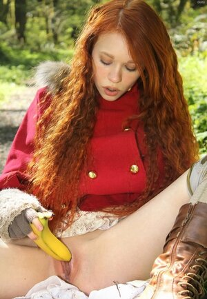 Tiny Red Riding Hood lost in the woods using banana to masturbate vagina