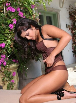 Xxx star in brown taking various poses and her big boobs in action