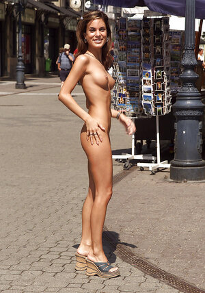 Bitch in high heels gets naked and also poses in the nude on the crowded street
